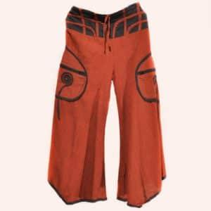 Красно-оранжевые брюки клеш